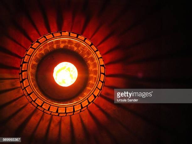 Pattern of burning lantern on dark table