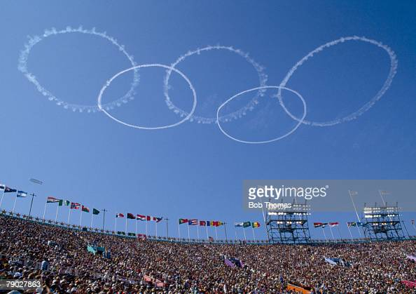 A pattern of five interlocking rings are formed as a display in the sky to represent the symbol of the Olympic Games above the Memorial Coliseum...