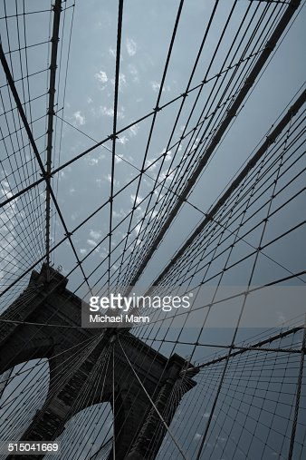 Pattern of steel cables of the Brooklyn Bridge, New York, USA