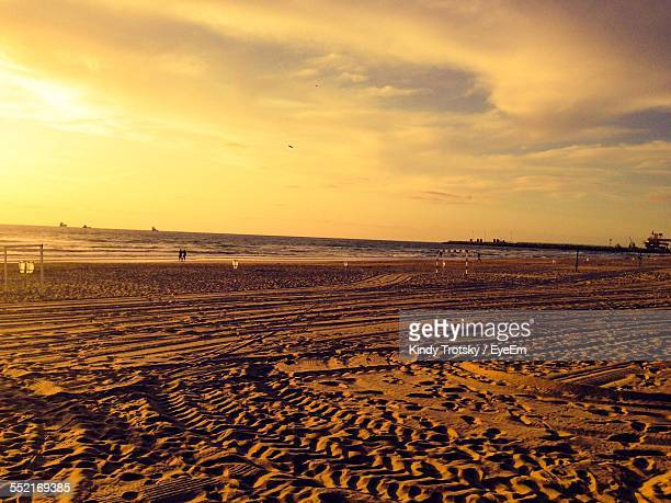 Pattern On Sandy Beach And Yellow Sky