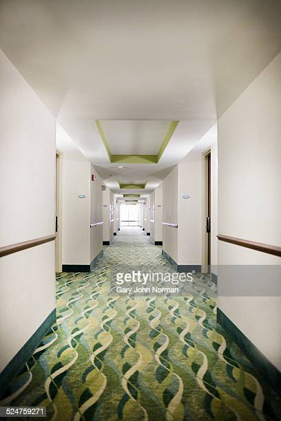 Patterned carpet in hotel corridor.