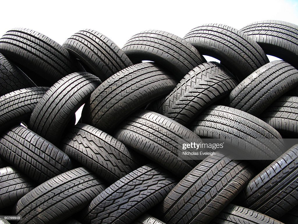 A patterned stack of automobile tires : Stock Photo