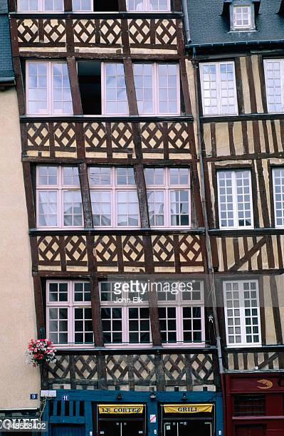 Patterned timber work adorns the front of one of the half-wooden houses to survive the great fire of 1720