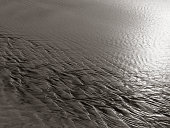 patterns created n the sand by waves and wind, sand pattern as background