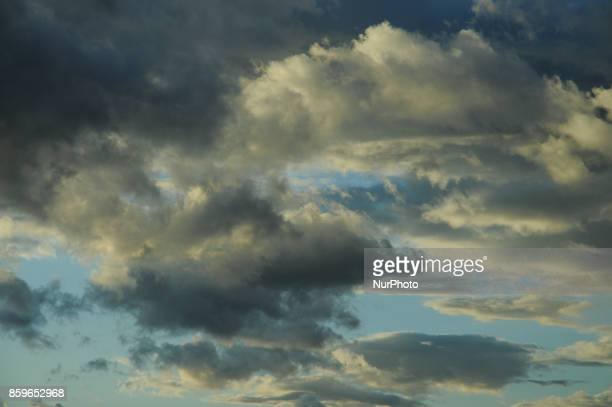 Patterns of clouds are seen at the sun sets in central Poland on October 9 2017