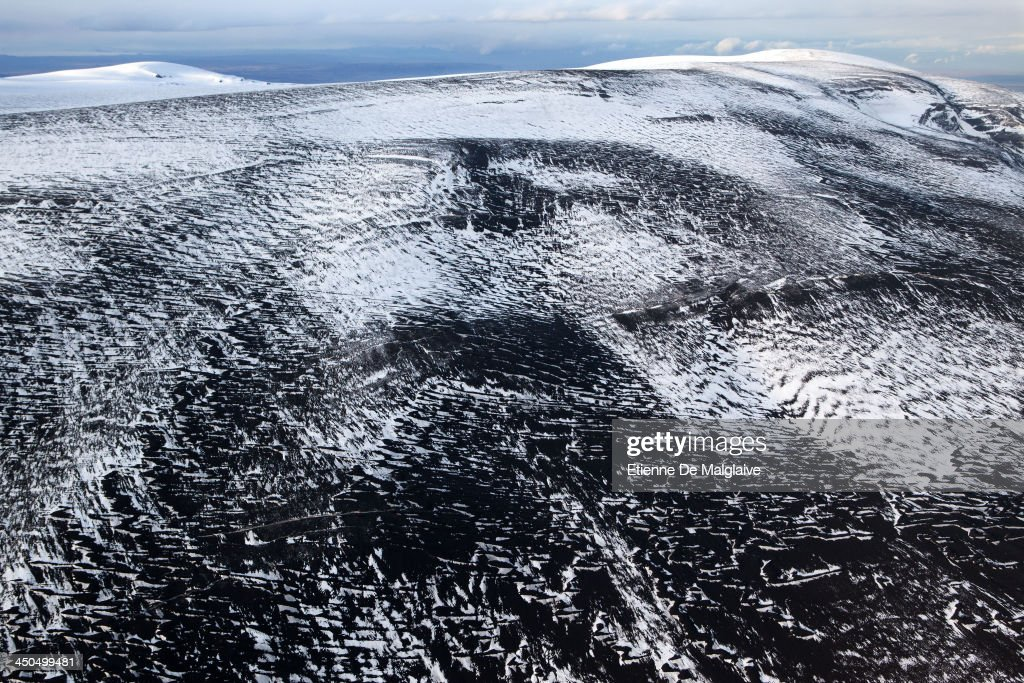 Patterns of dark ashes covering ice and snow of the glaciers surrounding the volcano Eyjafjallajokull, 120 km east of Iceland's capital Reykjavik on May 15, 2010 near Reykjavik, Iceland.