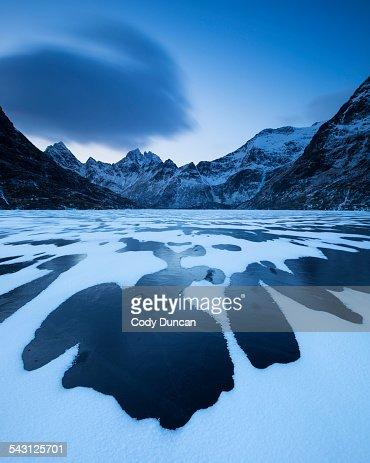 Patterns of snow cover black ice Lofoten Islands, Norway