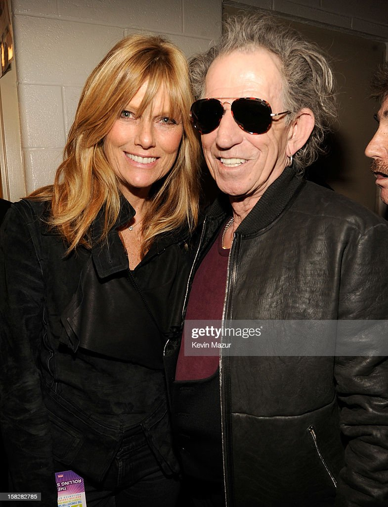 Patti Hansen and Keith Richards backstage during '12-12-12' a concert benefiting The Robin Hood Relief Fund to aid the victims of Hurricane Sandy presented by Clear Channel Media & Entertainment, The Madison Square Garden Company and The Weinstein Company>> at Madison Square Garden on December 12, 2012 in New York City.