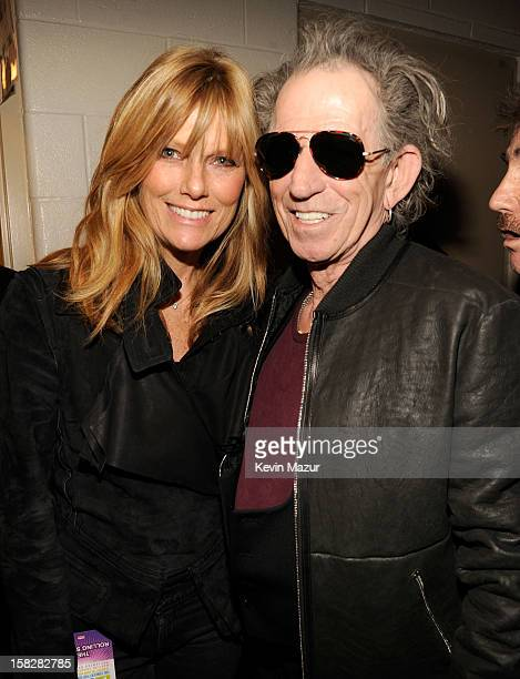 Patti Hansen and Keith Richards backstage during '121212' a concert benefiting The Robin Hood Relief Fund to aid the victims of Hurricane Sandy...
