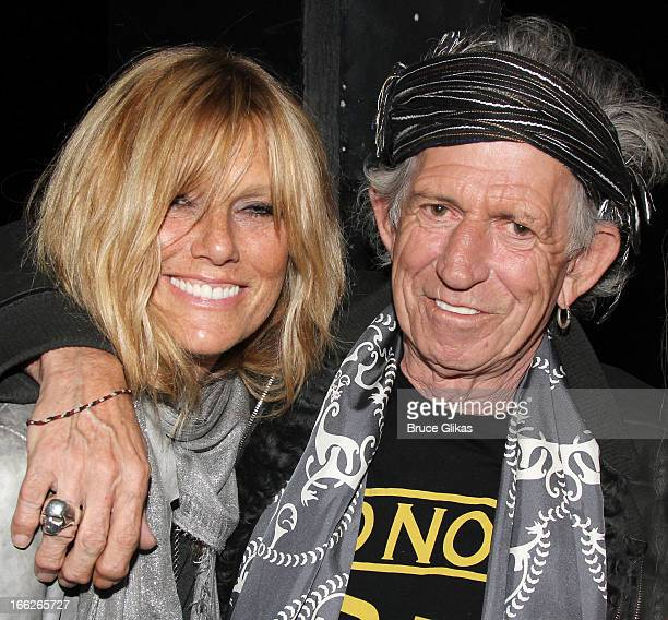 Patti Hansen and Keith Richards pose backstage at the hit musical 'Kinky Boots' on Broadway at The Al Hirshfeld Theater on April 10 2013 in New York...