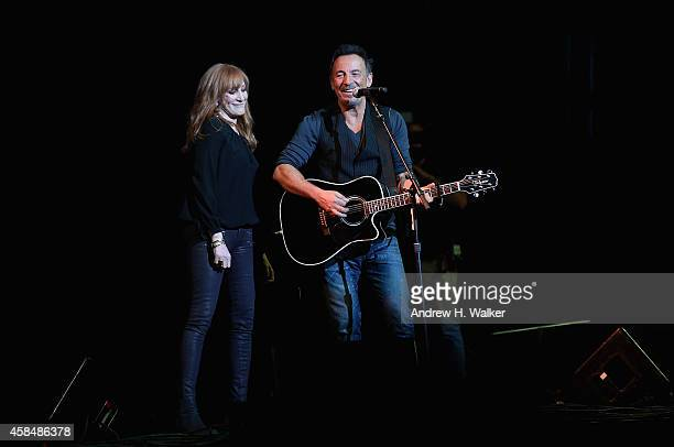 Patti Scialfa and Bruce Springsteen perform onstage at The New York Comedy Festival and The Bob Woodruff Foundation present the 8th Annual Stand Up...