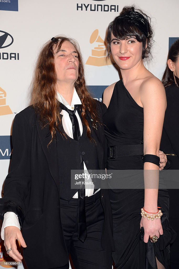 <a gi-track='captionPersonalityLinkClicked' href=/galleries/search?phrase=Patti+Smith+-+Godmother+of+Punk&family=editorial&specificpeople=221285 ng-click='$event.stopPropagation()'>Patti Smith</a> (L) and her daughter Jesse Smith arrive at Clive Davis and The Recording Academy's 2013 GRAMMY Salute to Industry Icons Gala held at The Beverly Hilton Hotel on February 9, 2013 in Beverly Hills, California.