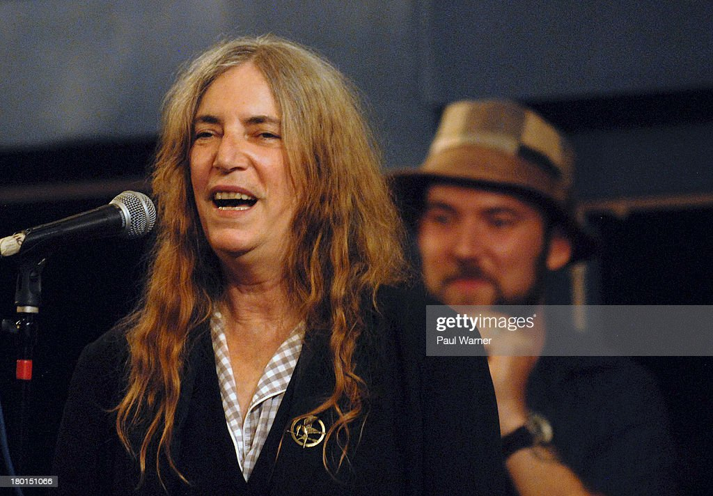 <a gi-track='captionPersonalityLinkClicked' href=/galleries/search?phrase=Patti+Smith+-+Godmother+of+Punk&family=editorial&specificpeople=221285 ng-click='$event.stopPropagation()'>Patti Smith</a> (L) and her son Jackson Smith perform at a benefit concert for Covenant House Michigan, a homeless shelter for children, at Sinbad's on September 8, 2013 in Detroit, Michigan.