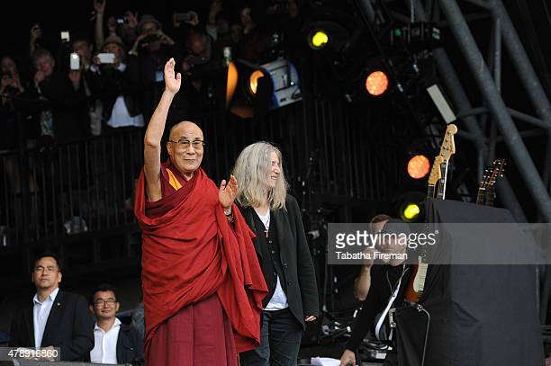 Patti Smith introduces the 14th Dalai Lama to the Pyramid stage festival crowd to celebrate his 80th Birthday at the Glastonbury Festival at Worthy...