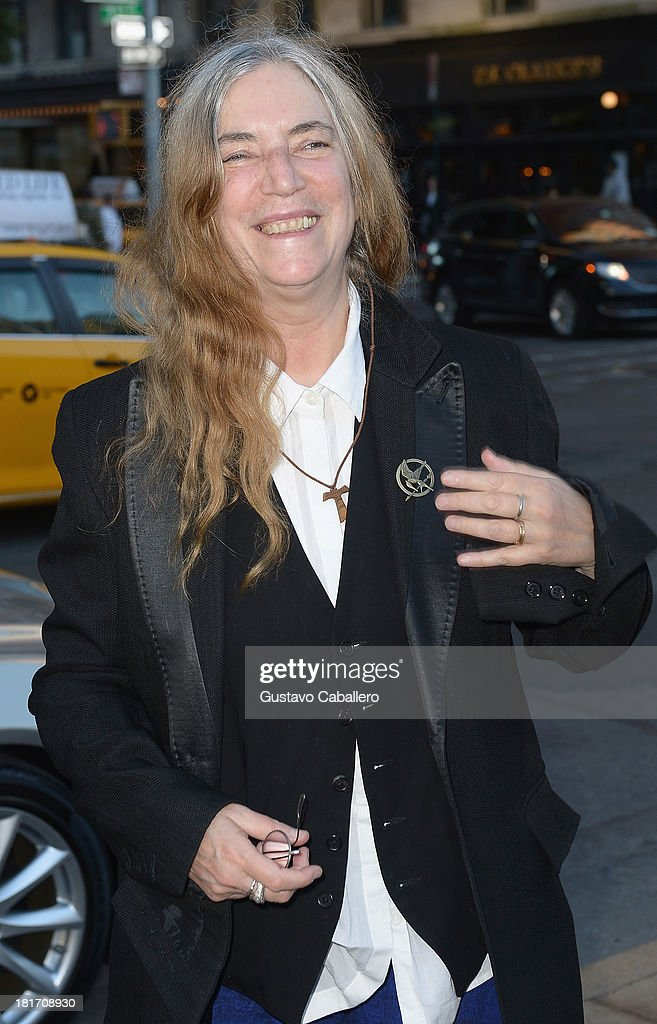 <a gi-track='captionPersonalityLinkClicked' href=/galleries/search?phrase=Patti+Smith+-+Godmother+of+Punk&family=editorial&specificpeople=221285 ng-click='$event.stopPropagation()'>Patti Smith</a> is seen New York on September 23, 2013 in New York City.