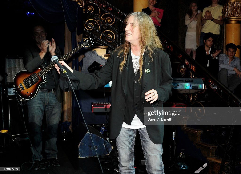 REQUIRED) <a gi-track='captionPersonalityLinkClicked' href=/galleries/search?phrase=Patti+Smith+-+Godmother+of+Punk&family=editorial&specificpeople=221285 ng-click='$event.stopPropagation()'>Patti Smith</a> performs at the Hoping Foundation's 'Rock On' benefit evening for Palestinian refugee children at Cafe de Paris on June 20, 2013 in London, England.