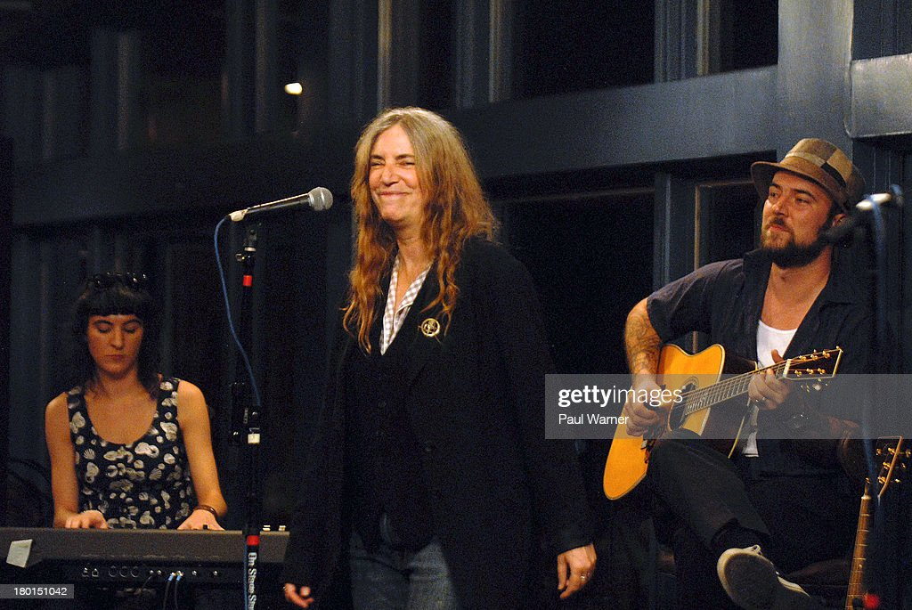 Patti Smith (C) performs with her children Jesse Smith (L) and Jackson Smith at a benefit concert for Covenant House Michigan, a homeless shelter for children, at Sinbad's on September 8, 2013 in Detroit, Michigan.