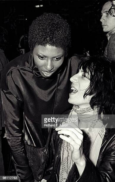 Patti Smith posed with Nona Hendryx from Labelle at a poetry reading night at a club called Local in New York City in 1975