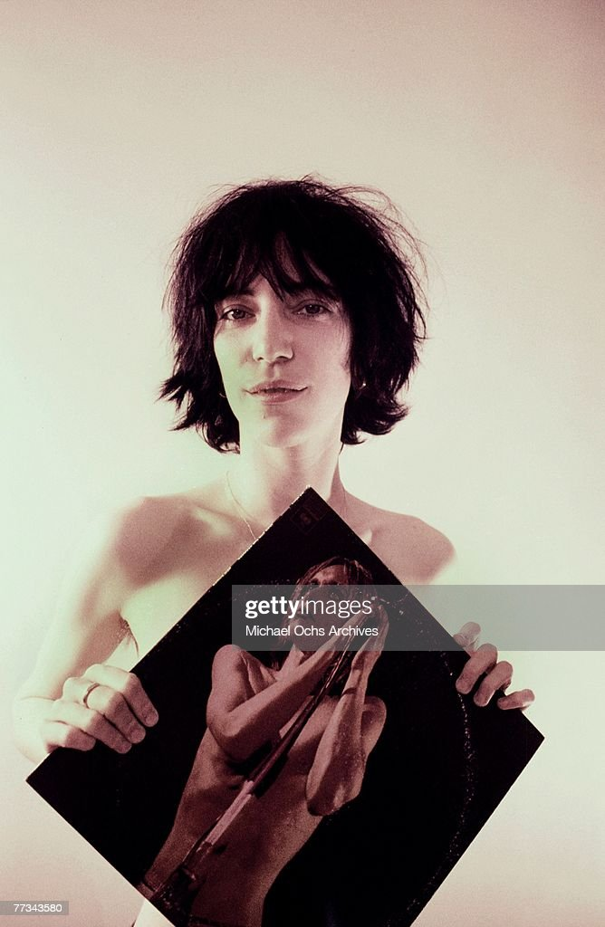 Patti Smith poses with an <a gi-track='captionPersonalityLinkClicked' href=/galleries/search?phrase=Iggy+Pop&family=editorial&specificpeople=171445 ng-click='$event.stopPropagation()'>Iggy Pop</a> album in November 1974 in Los Angeles California.