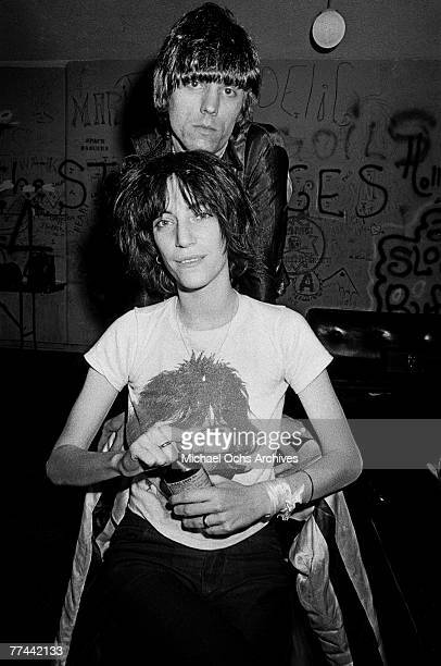 Patti Smith poses with James Williamson of The Stooges in November 1974 backstage at the Whisky a Go Go in Los Angeles California