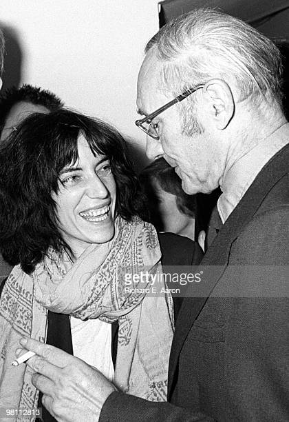 Patti Smith with writer William Burroughs at a poetry reading night at a club called Local in New York City in 1975