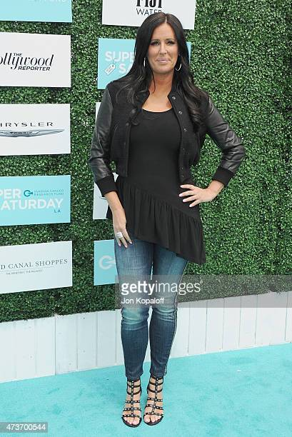 Patti Stanger arrives at the Ovarian Cancer Research Fund's 2nd Annual Super Saturday LA at Barker Hangar on May 16 2015 in Santa Monica California