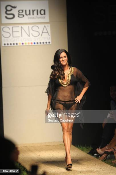 Patti Stanger walks the runway during Guria Swimwear presented by SENSA at Funkshion on October 12 2012 in Miami Beach Florida