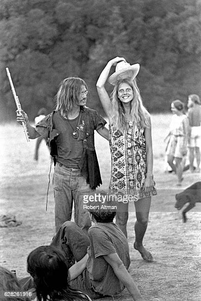 Patti tips her hat as her friend carries a flute on Mount Tamalpais on September 30 1969 in San Francisco California