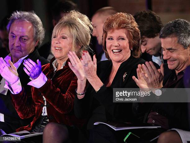Pattie Boyd and Cilla Black laugh during the auction at Hidden Gems Photography Gala Auction in support of Variety Club at St Pancras Renaissance...