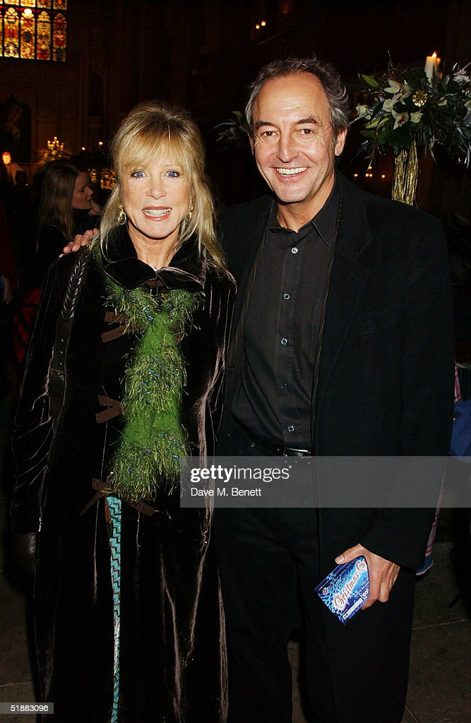 Pattie Boyd and guest attend the 'Nordoff-Robbins Christmas Carol Concert', an annual concert in aid of the music therapy charity, at St Luke's Church on December 20, 2004 in London.