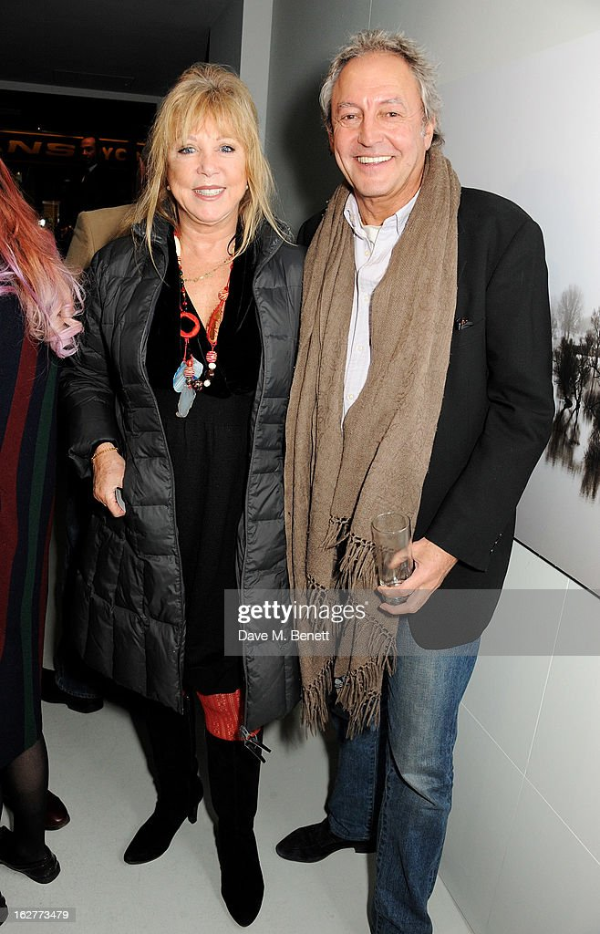 Pattie Boyd (L) and Rod Weston attend a private view of Bill Wyman's new exhibit 'Reworked' at Rook & Raven Gallery on February 26, 2013 in London, England.