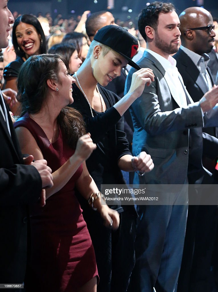 Pattie Mallette and singer Justin Bieber at the 40th American Music Awards held at Nokia Theatre LA Live on November 18 2012 in Los Angeles California