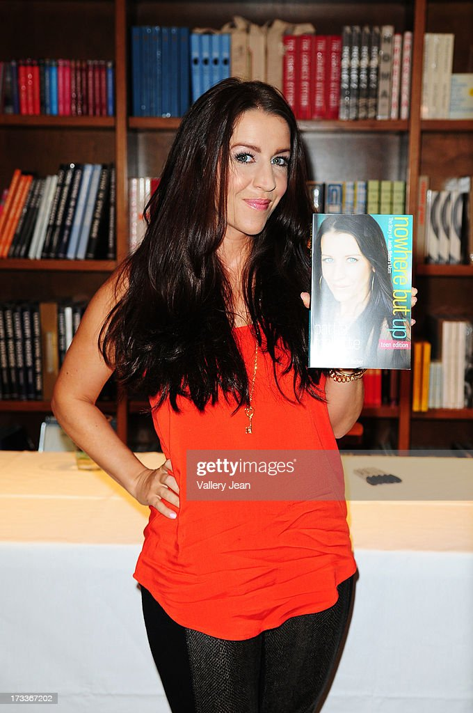 <a gi-track='captionPersonalityLinkClicked' href=/galleries/search?phrase=Pattie+Mallette&family=editorial&specificpeople=6718278 ng-click='$event.stopPropagation()'>Pattie Mallette</a>, mother of Justin Bieber, signs copies of her book 'Nowhere But Up - Teen Edition' at Books and Books on July 12, 2013 in Coral Gables, Florida.
