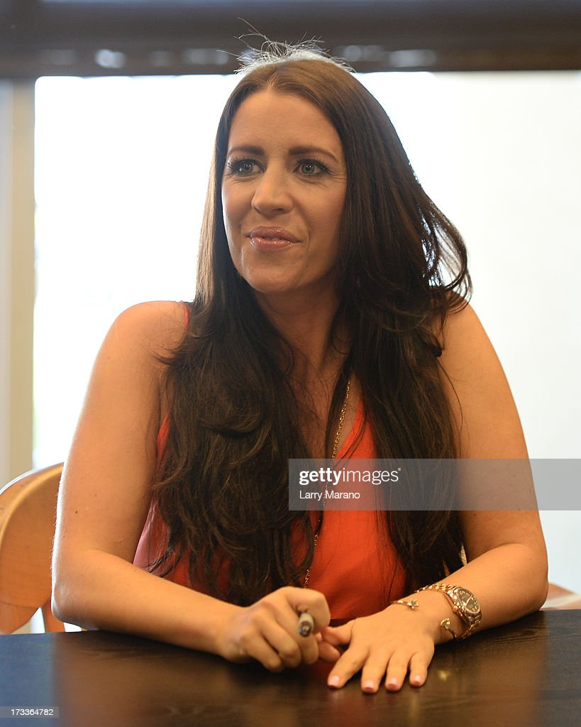 <a gi-track='captionPersonalityLinkClicked' href=/galleries/search?phrase=Pattie+Mallette&family=editorial&specificpeople=6718278 ng-click='$event.stopPropagation()'>Pattie Mallette</a> signs copies of 'Nowhere But Up' at Barnes & Noble on July 12, 2013 in Fort Lauderdale, Florida.