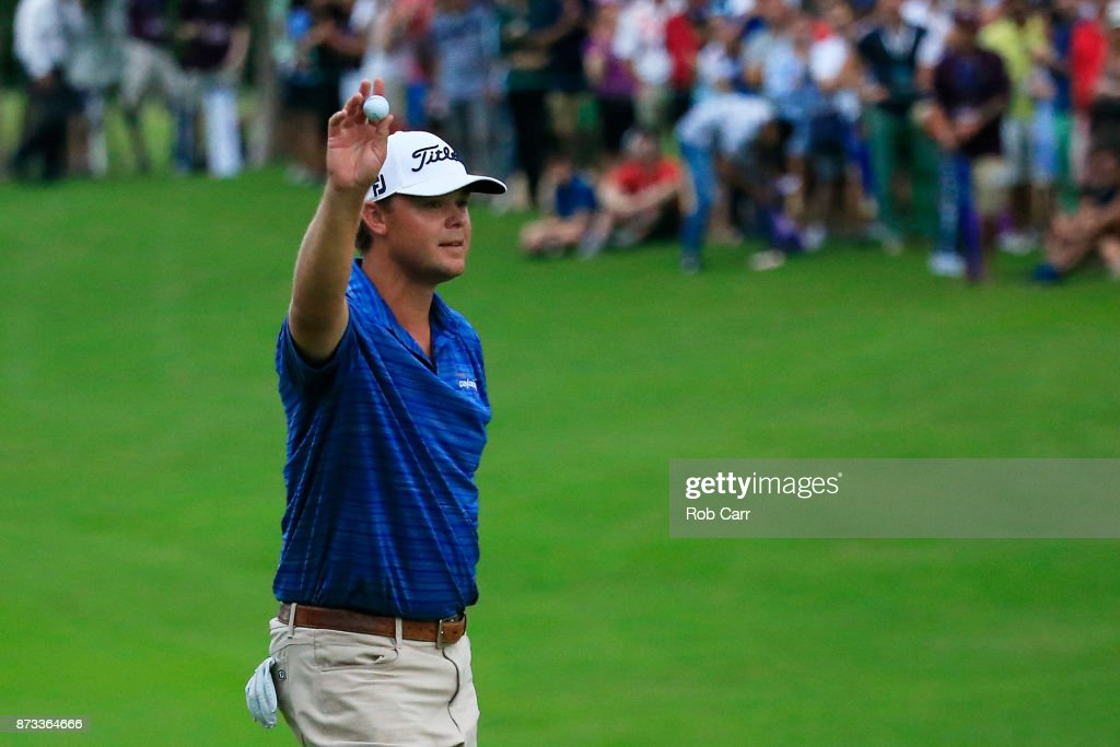 Patton Kizzire of the United States celebrates on the 18th green after winning during the final round of the OHL Classic at Mayakoba on November 12, 2017 in Playa del Carmen, Mexico.