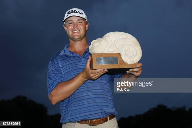 Patton Kizzire of the United States celebrates with the trophy on the 18th green after winning during the final round of the OHL Classic at Mayakoba...