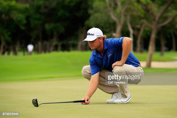 Patton Kizzire of the United States lines up a putt on the sixth green during the final round of the OHL Classic at Mayakoba on November 12 2017 in...