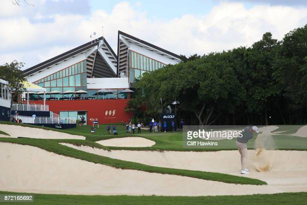 Patton Kizzire of the United States plays a shot from a bunker on the 18th hole during the first round of the OHL Classic at Mayakoba on November 9...