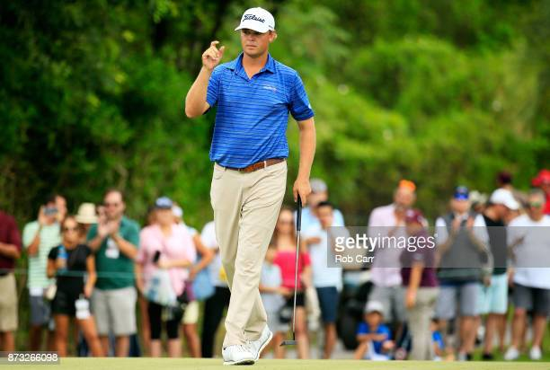 Patton Kizzire of the United States reacts to his birdie on the 17th green during the continuation of the third round of the OHL Classic at Mayakoba...