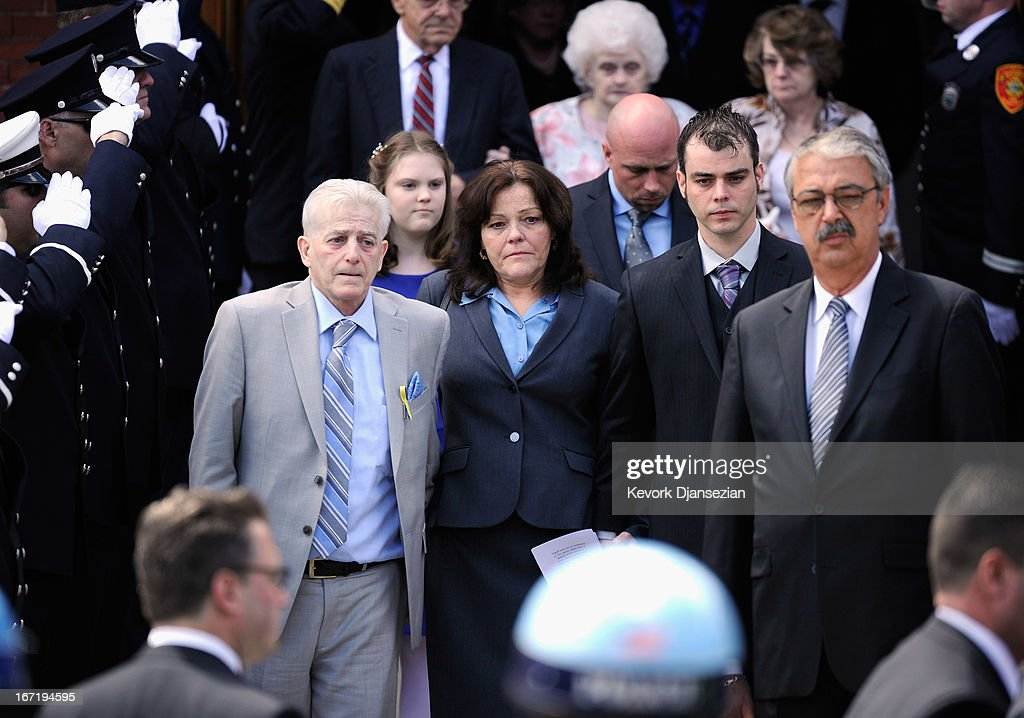 Patty Cambell (3rd L), mother of Krystle Campbell, a victim of the Boston Marathon bombing, and brother Billy Campbell (2nd R) walk out of St. Joseph Catholic Church after the funeral service on April 22, 2013 in Medford, Massachusetts. A manhunt ended for Dzhokhar A. Tsarnaev, 19, a suspect in the Boston Marathon bombing after he was apprehended on a boat parked on a residential property in Watertown, Massachusetts. His brother Tamerlan Tsarnaev, 26, the other suspect, was shot and killed after a car chase and shootout with police. The bombing, on April 15 at the finish line of the marathon, killed three people and wounded at least 170.