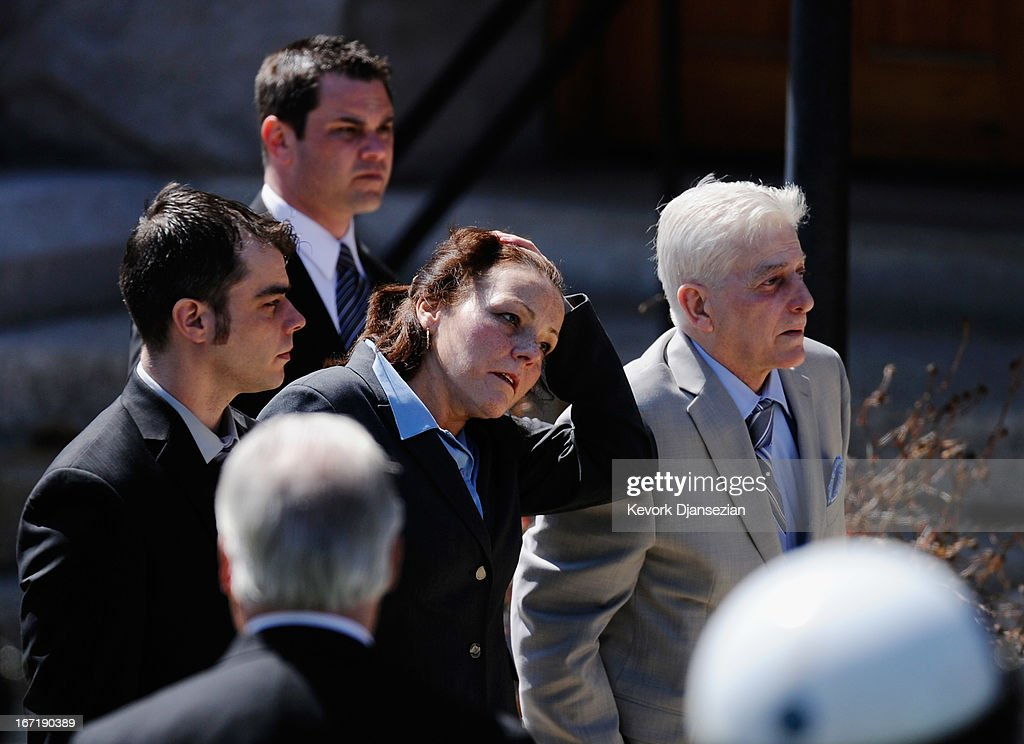 Patty Cambell (C) mother of Krystle Campbell, a victim of the Boston Marathon bombing, arrives with family memebrs to St. Joseph Catholic Church for her funeral on April 22, 2013 in Medford, Massachusetts. A manhunt ended for Dzhokhar A. Tsarnaev, 19, a suspect in the Boston Marathon bombing after he was apprehended on a boat parked on a residential property in Watertown, Massachusetts. His brother Tamerlan Tsarnaev, 26, the other suspect, was shot and killed after a car chase and shootout with police. The bombing, on April 15 at the finish line of the marathon, killed three people and wounded at least 170.