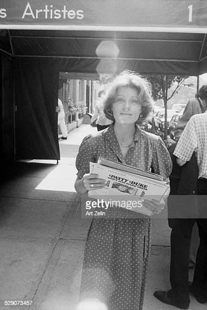 Patty Duke Austin walking on the street carrying LP albums circa 1960 New York