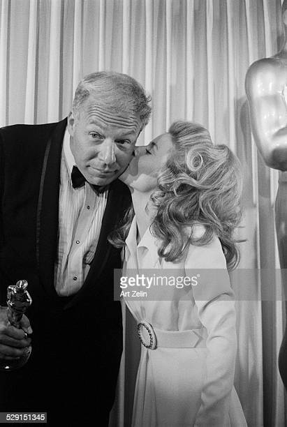 Patty Duke kissing George Kennedy after she presented him with the Academy Award for Cool Hand Luke 1968 New York