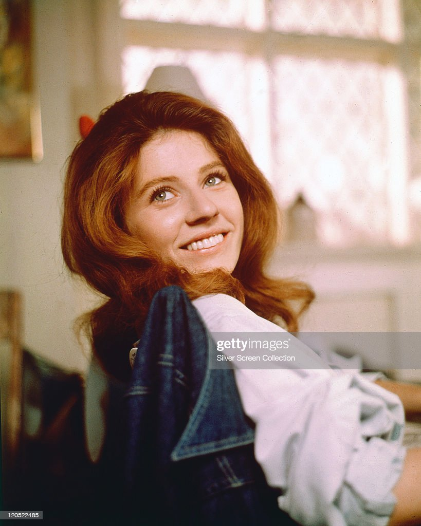 <a gi-track='captionPersonalityLinkClicked' href=/galleries/search?phrase=Patty+Duke&family=editorial&specificpeople=93921 ng-click='$event.stopPropagation()'>Patty Duke</a>, US actress, smiling as she turns her head toward the camera for a portrait, while sitting in a chair with a denim jacket on the backrest, circa 1970.
