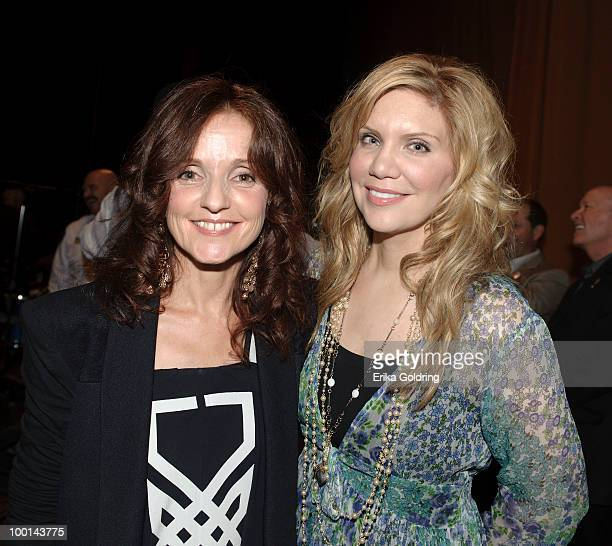 Patty Griffin and Alison Krauss backstage during the Music Saves Mountains benefit concert at the Ryman Auditorium on May 19 2010 in Nashville...