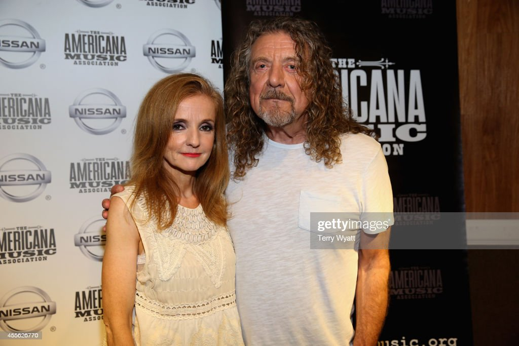 Patty Griffin and Robert Plant pose backstage at the 13th annual Americana Music Association Honors and Awards Show at the Ryman Auditorium on September 17, 2014 in Nashville, Tennessee.