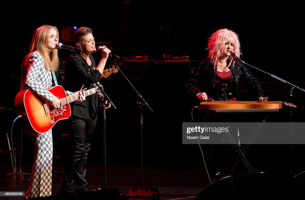 Patty Griffin, Natalie Maines and Cyndi Lauper perform during the 4th Annual 'Home For The Holidays' Benefit Concert at Beacon Theatre on December 6, 2014 in New York City.