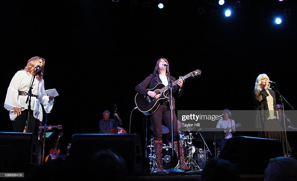 Patty Loveless, Kathy Mattea and Emmylou Harris perform during the Music Saves Mountains benefit concert at the Ryman Auditorium on May 19, 2010 in Nashville, Tennessee.