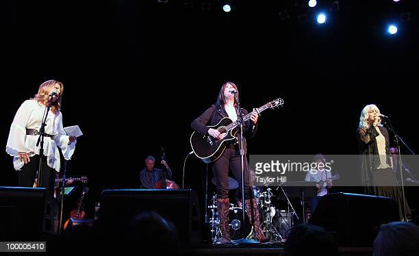 Patty Loveless Kathy Mattea and Emmylou Harris perform during the Music Saves Mountains benefit concert at the Ryman Auditorium on May 19 2010 in...