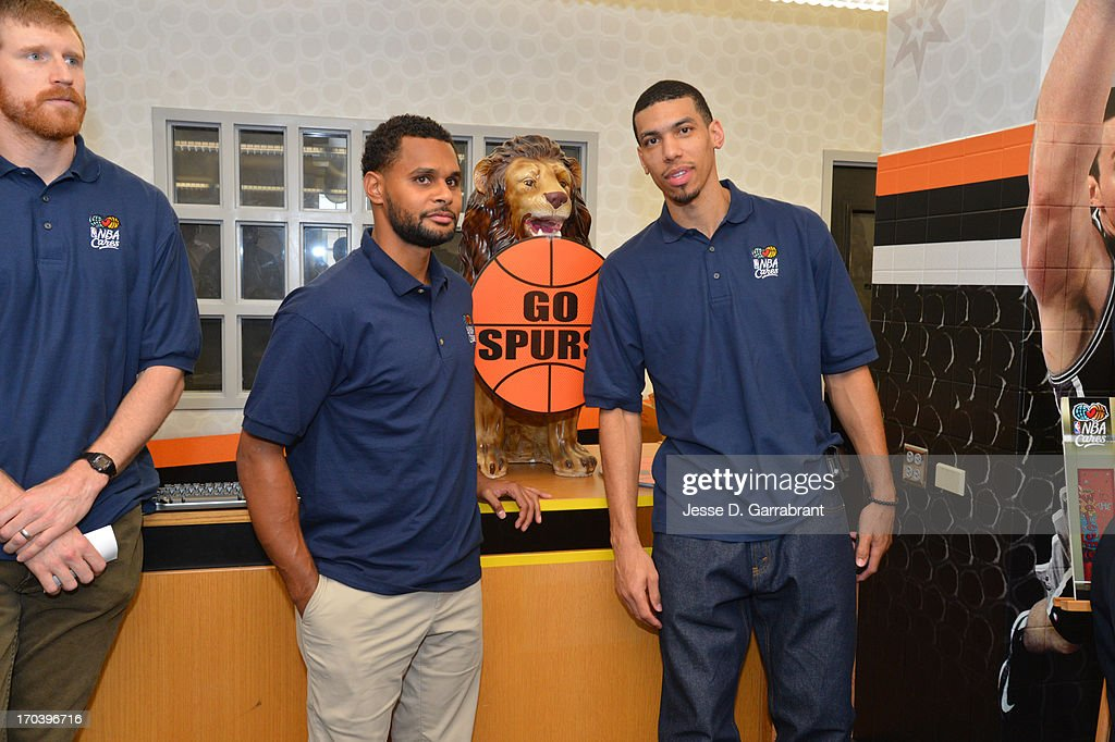 Patty Mills and Danny Green of the San Antonio Spurs at the 2013 NBA Cares Legacy Project as part of the 2013 NBA Finals on June 7, 2013 at the Wheatley Middle School in San Antonio, Texas.
